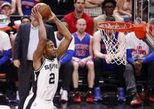 Mar 2, 2016; San Antonio, TX, USA; San Antonio Spurs small forward Kawhi Leonard (2) dunks the ball against the Detroit Pistons during the second half at AT&T Center. Mandatory Credit: Soobum Im-USA TODAY Sports