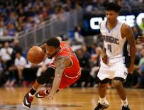 Mar 2, 2016; Orlando, FL, USA; Orlando Magic guard Elfrid Payton (4) trips Chicago Bulls guard Aaron Brooks (0) during the second half of a basketball game at Amway Center. Mandatory Credit: Reinhold Matay-USA TODAY Sports