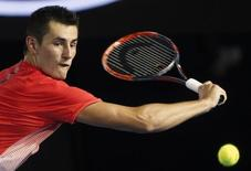 File photo of Australia's Bernard Tomic hits a shot during his third round match against compatriot John Millman at the Australian Open tennis tournament at Melbourne Park, Australia, January 24, 2016. REUTERS/Brandon Malone