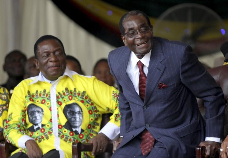 Zimbabwe's President Robert Mugabe (R) shares a joke with his vice-President  Emmerson Mnangagwa during Mugabe's birthday celebrations at Great Zimbabwe in Masvingo, February 27, 2016. REUTERS/Philimon Bulawayo