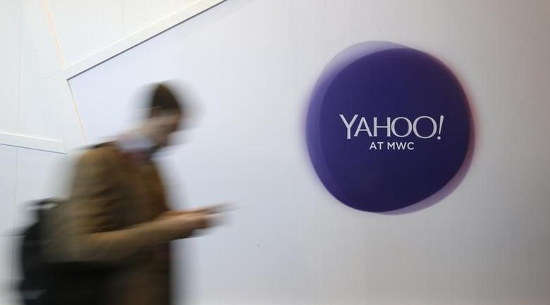 A man walks past a Yahoo logo during the Mobile World Congress in Barcelona, Spain February 24, 2016. REUTERS/Albert Gea