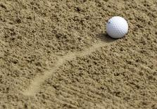 A ball lies in the sand of a bunker on the 18th hole during the second day of the European Masters golf in Crans-Montana in this September 2, 2011 file photo. REUTERS/Denis Balibouse