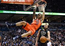 Mar 6, 2016; Milwaukee, WI, USA;  Oklahoma City Thunder center Steven Adams (12) dunks a basket in front of Milwaukee Bucks center Miles Plumlee (18) in the second quarter at BMO Harris Bradley Center. Mandatory Credit: Benny Sieu-USA TODAY Sports