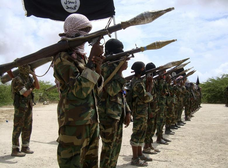 Al Shabaab militants parade new recruits after arriving in Mogadishufrom their training camp south of the capital in this October 21, 2010 file photo. REUTERS/Feisal Omar/Files