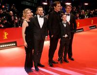 Actors Kirsten Dunst, Joel Egerton, Michael Shannon, Jaeden Lieberher and director Jeff Nichols (L-R) arrive on the red carpet for the screening of the movie 'Midnight Special' at the 66th Berlinale International Film Festival in Berlin February 12, 2016.    REUTERS/Fabrizio Bensch