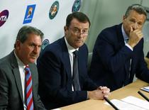 International Tennis Federation (ITF) President David Haggerty (L-R), Tennis Integrity Board Chairman Philip Brook and Association of Tennis Professionals (ATP) Chairman Chris Kermode hold a news conference at the Australian Open tennis tournament at Melbourne Park, Australia, January 27, 2016. REUTERS/Thomas Peter