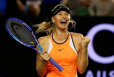 Russia's Maria Sharapova celebrates after winning her fourth round match against Switzerland's Belinda Bencic at the Australian Open tennis tournament at Melbourne Park, Australia, January 24, 2016. REUTERS/Thomas Peter