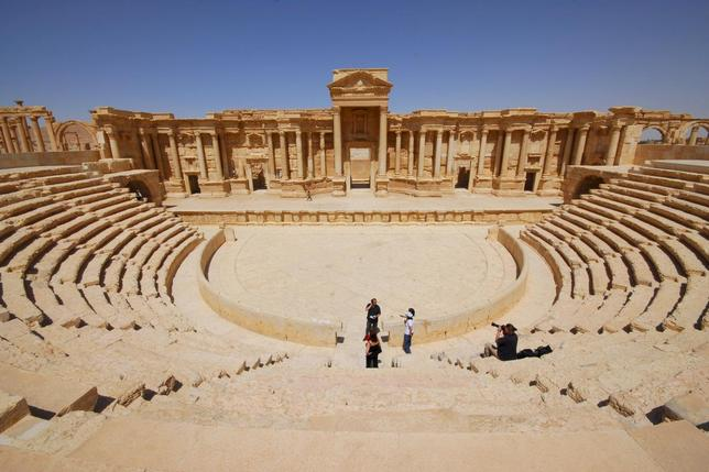 Tourists take pictures at the ancient Palmyra theater in the historical city of Palmyra, Syria in this April 18, 2008 file photo. REUTERS/Omar Sanadiki/Files