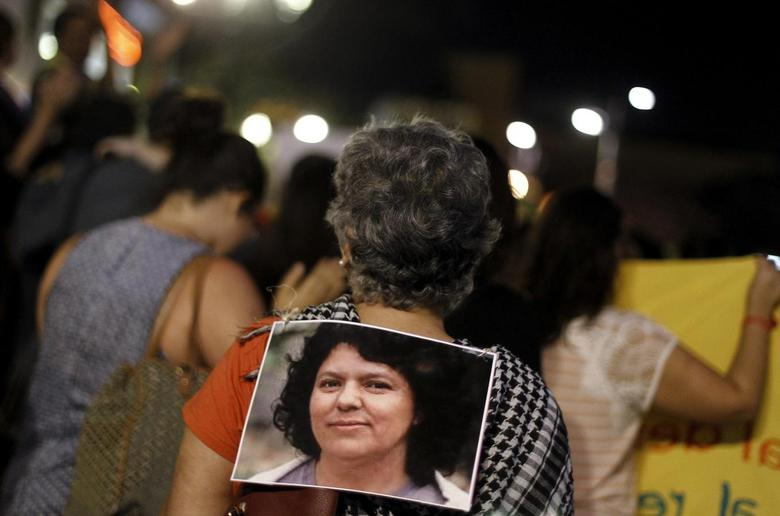 An activist carries a photo of slain environmental rights activist Berta Caceres on her back during a protest to mark International Women's Day in San Jose, Costa Rica March 8, 2016. REUTERS/Juan Carlos Ulate - RTS9XAB