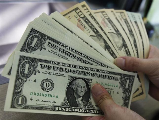 3月11日、午後3時のドル/円は、前日ニューヨーク市場午後5時時点に比べてドル高/円安の113.40/42円だった。写真は都内で2011年8月撮影(2016年 ロイター/Yuriko Nakao)