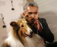 Dog trainer Cesar Millan poses with Lassie at 2008 Primetime Creative Arts Awards in Los Angeles September 13, 2008.  REUTERS/Mario Anzuoni/Files