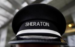 A doorman's hat at Sheraton hotel, a brand of Starwood Hotels & Resorts Worldwide, is pictured in Warsaw February 24, 2012.  REUTERS/Kacper Pempel (POLAND  - Tags: BUSINESS LOGO TRAVEL)   - RTR2YDMS