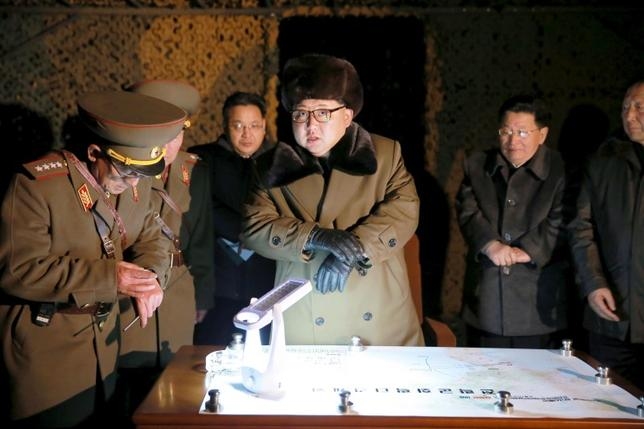North Korean leader Kim Jong Un talks with officials at the ballistic rocket launch drill of the Strategic Force of the Korean People's Army (KPA) at an unknown location, in this undated photo released by North Korea's Korean Central News Agency (KCNA) in Pyongyang on March 11, 2016.  REUTERS/KCNA