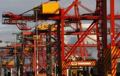Shipping container cranes are seen at the Patrick port facility in Melbourne in this June 9, 2009 file photo. REUTERS/Mick Tsikas/Files