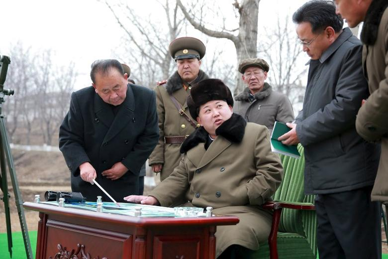 North Korean leader Kim Jong Un gives instruction during a simulated test of atmospheric re-entry of a ballistic missile, at an unidentified location in this undated photo released by North Korea's Korean Central News Agency (KCNA) in Pyongyang on March 15, 2016.       REUTERS/KCNA
