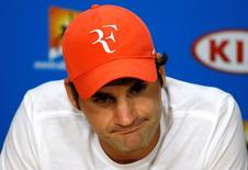 Switzerland's Roger Federer reacts during a news conference after losing his semi-final match against Serbia's Novak Djokovic at the Australian Open tennis tournament at Melbourne Park, Australia, January 28, 2016. REUTERS/Issei Kato - RTX24E06