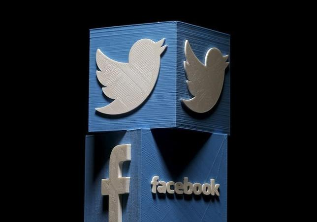 3D-printed Facebook and Twitter logos are seen in this picture illustration made in Zenica, Bosnia and Herzegovina on January 26, 2016. REUTERS/Dado Ruvic/Files
