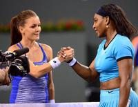 Mar 18, 2016; Indian Wells, CA, USA; Serena Williams (USA) shakes hands with Agnieszka Radwanska (POL) after their semi final match in the BNP Paribas Open at the Indian Wells Tennis Garden. Williams won 6-4, 7-6. Mandatory Credit: Jayne Kamin-Oncea-USA TODAY Sports