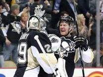 Mar 15, 2016; Pittsburgh, PA, USA; Pittsburgh Penguins goalie Marc-Andre Fleury (29) and Penguins right wing Patric Hornqvist (R) react after defeating the New York Islanders in a shootout at the CONSOL Energy Center. Mandatory Credit: Charles LeClaire-USA TODAY Sports