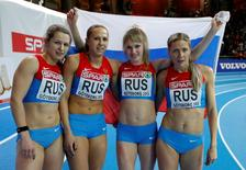 Olga Tovarovna, Tatyana Veshkurova, Nadezhda Kotlyarova and Kseniya Zadorina of Russia (L to R) celebrate as they took second place at the women's 4x400m Relay event during the European Athletics Indoor Championships in Gothenburg March 3, 2013.  REUTERS/Phil Noble