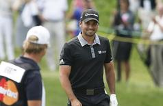 Mar 20, 2016; Orlando, FL, USA; Jason Day of Australia smiles as he walks onto the second green after chipping the ball in for a birdie during the final round of the Arnold Palmer Invitational presented by Master Card at Bay Hill Club and Lodge. Mandatory Credit: Reinhold Matay-USA TODAY Sports