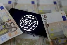 The Swift code bank logo is displayed on an iPhone 6s on top of Euro banknotes in this file illustration photo January 26, 2016. REUTERS/Dado Ruvic/Illustration/Files