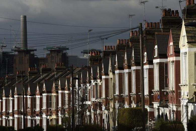 The one new new chimney of Battersea Power Station is seen behind a residential street in London, Britain, March 7, 2016.  REUTERS/Toby Melville