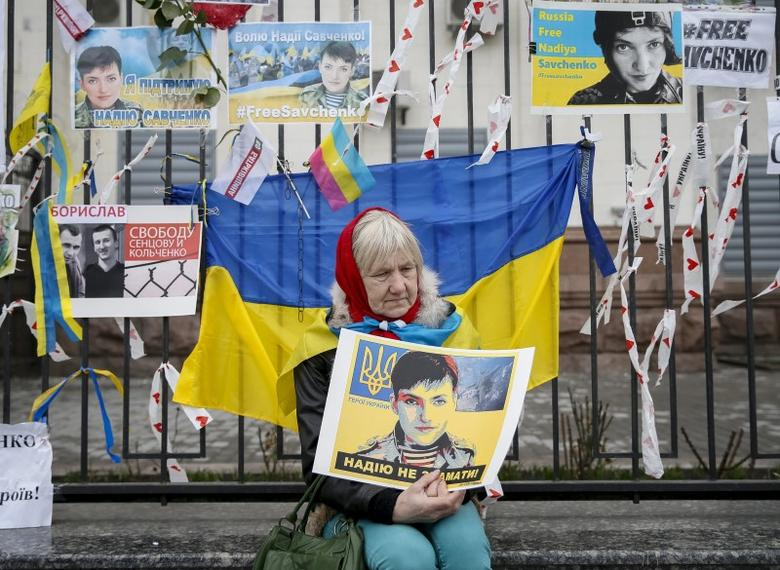 A woman takes part in a protest in front of the Russian embassy demanding the liberation of Ukrainian army pilot Nadezhda Savchenko by Russia, in Kiev, Ukraine, March 22, 2016. REUTERS/Gleb Garanich