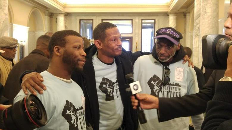 Ex-felon Perry Hopkins (C) is seen with Marcus Toles (L), and Reginald Smith (R) at the Maryland Senate building in Annapolis, Maryland, February 9, 2016 in this handout picture. With Maryland last month joining the nationwide bipartisan trend making it easier for ex-convicts to vote, the 55-year-old Baltimore native will cast a ballot for the first time in his life. REUTERS/Jane Henderson/Handout via Reuters