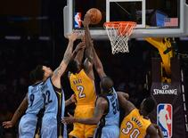 Los Angeles Lakers forward Brandon Bass (2) is defended by Memphis Grizzlies guard Tony Allen (9), forward Matt Barnes (22) and forward Zach Randolph (50) during an NBA game at Staples Center. The Lakers defeated the Grizzlies 107-100.  Mandatory Credit: Kirby Lee-USA TODAY Sports
