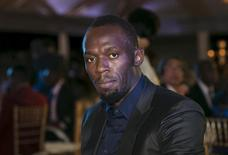Jamaican sprinter Usain Bolt poses for a photograph while attending the Prime Minister's Awards 2015 event, held to celebrate the outstanding performance of athletes, in Kingston October 16, 2015. REUTERS/Gilbert Bellamy/Files