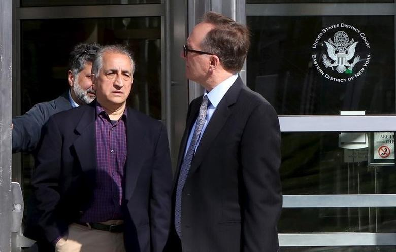Ahmad Sheikhzadeh (C), a consultant to the Iranian mission to the United Nation, leaves Brooklyn Federal Court in New York, March 23, 2016. REUTERS/Pearl Gabel