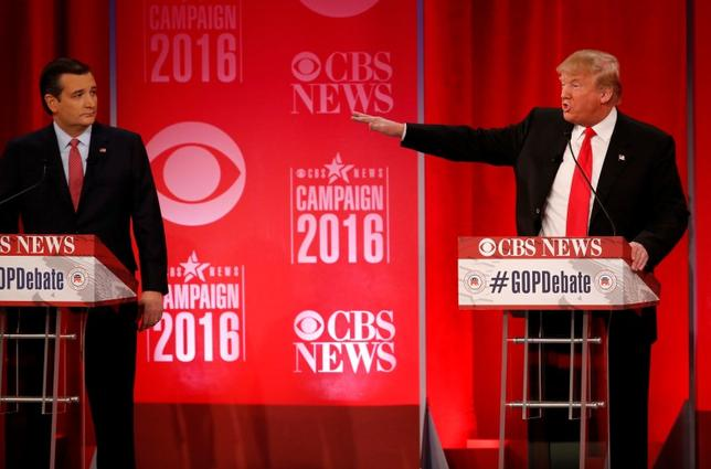 Republican U.S. presidential candidate Senator Ted Cruz (L) looks on as businessman Donald Trump speaks at the Republican U.S. presidential candidates debate sponsored by CBS News and the Republican National Committee in Greenville, South Carolina February 13, 2016. REUTERS/Jonathan Ernst