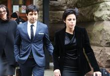 Former Canadian radio host Jian Ghomeshi leaves court with his attorney Marie Henein (R), after an Ontario judge found him not guilty on four sexual assault charges and one count of choking in Toronto, March 24, 2016.  REUTERS/Jenna Marie Wakani