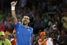 Mar 25, 2016; Key Biscayne, FL, USA; Novak Djokovic waves to fans after his match against Kyle Edmund (not pictured) during day four of the Miami Open at Crandon Park Tennis Center. Djokovic  won 6-3, 6-3. Mandatory Credit: Geoff Burke-USA TODAY Sports -