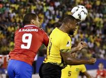 Football Soccer - Jamaica v Costa Rica - World Cup 2018 Qualifier, at the National Stadium in Kingston, Jamaica, 25/3/16. Wes Morgan of Jamaica and Alvaro Saborio (9) of Costa Rica in action. REUTERS/Gilbert Bellamy