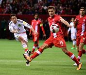 Mar 25, 2016; Vancouver, British Columbia, CAN; Mexico Javier Herhandez (14) passes the ball against Canada midfielder Adam Straith (15)  during the second half at BC Place. Mexico won 3-0. Mandatory Credit: Anne-Marie Sorvin-USA TODAY Sports