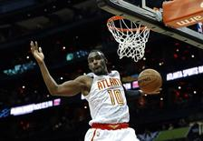 Mar 25, 2016; Atlanta, GA, USA; Atlanta Hawks guard Tim Hardaway Jr. (10) dunks in the fourth quarter of their game against the Milwaukee Bucks at Philips Arena. The Hawks won 101-90. Mandatory Credit: Jason Getz-USA TODAY Sports