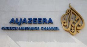 The logo of Qatar-based Al Jazeera satellite news channel is seen in Doha February 7, 2011. REUTERS/ Fadi Al-Assaad