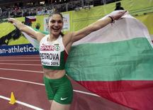 Second placed Gabriela Petrova of Bulgaria celebrates after the women's triple jump final during the European Indoor Championships in Prague March 8, 2015. REUTERS/David W Cerny