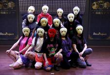Members of Japanese idol group Kamen Joshi (Masked Girls)  pose for a photo after a rehearsal for a concert at their theatre in Tokyo's Akihabara district, Japan March 17, 2016.  REUTERS/Toru Hanai