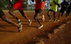 Athletes exercise in the early morning in the sports ground of the University of Eldoret in western Kenya, March 21, 2016. REUTERS/Siegfried Modola