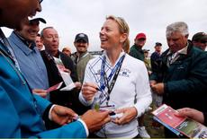Former professional golfer Annika Sorenstam of Sweden signs autographs during the second round of the U.S. Open Golf Championship in Pebble Beach, California, in this file photo dated June 18, 2010. REUTERS/Hans Deryk
