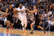 Mar 31, 2016; Oklahoma City, OK, USA; Oklahoma City Thunder forward Kevin Durant (35) drives to the basket between Los Angeles Clippers forward Wesley Johnson (33) and Los Angeles Clippers guard Pablo Prigioni (9) during the fourth quarter at Chesapeake Energy Arena. Mark D. Smith-USA TODAY Sports