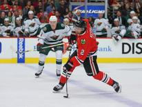 Dec 1, 2015; Chicago, IL, USA; Chicago Blackhawks defenseman Duncan Keith (2) takes a snapshot during the first period against the Minnesota Wild at the United Center. Mandatory Credit: Dennis Wierzbicki-USA TODAY Sports