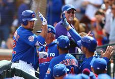 Mar 29, 2016; Mesa, AZ, USA; Chicago Cubs outfielder Kyle Schwarber (left) is congratulated by teammates after hitting a home run in the first inning against the Oakland Athletics during a spring training game at Sloan Park. Mandatory Credit: Mark J. Rebilas-USA TODAY Sports