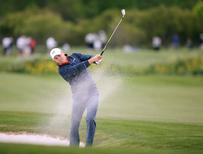 Apr 1, 2016; Humble, TX, USA; Jordan Spieth hits out of the trap on #18 during the second round of the Shell Houston Open at Golf Club of Houston - The Tournament Course. Mandatory Credit: Erich Schlegel-USA TODAY Sports