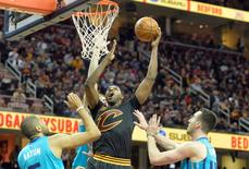 Apr 3, 2016; Cleveland, OH, USA; Cleveland Cavaliers center Tristan Thompson (13) rebounds between Charlotte Hornets guard Nicolas Batum (5) and center Frank Kaminsky III (44) in the second quarter at Quicken Loans Arena. David Richard-USA TODAY Sports