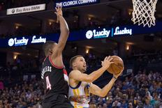 April 3, 2016; Oakland, CA, USA; Golden State Warriors guard Stephen Curry (30) shoots the basketball against Portland Trail Blazers forward Maurice Harkless (4) during the fourth quarter at Oracle Arena.  Kyle Terada-USA TODAY Sports