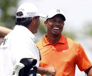 Tiger Woods of the U.S.  with Fred Couple's caddie, Cayce Kerr (L), on the tee of the third hole during the first round of the Memorial Tournament at Muirfield Village Golf Club in Dublin, Ohio May 30, 2013.  REUTERS/Matt Sullivan